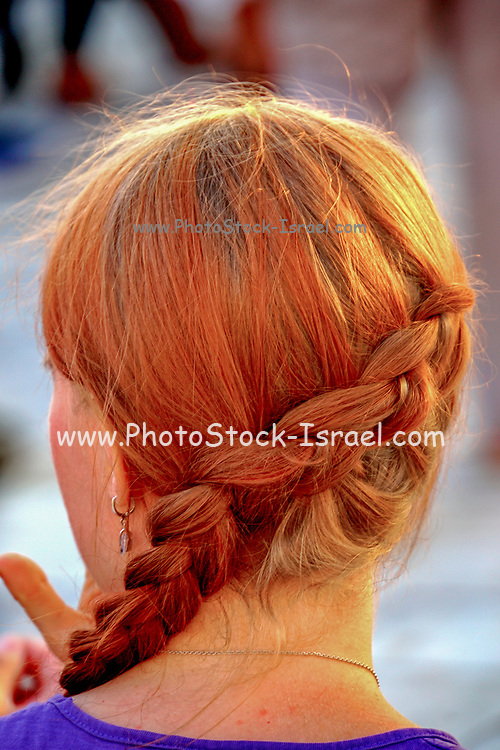 Braided ginger hair on a young woman as seen from the back of her head close up