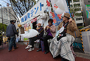 "Women hold dove shaped balloons at the anti nuclear Occupy Kasumigasaki camp outside the METI building in Kasumigaseki, Tokyo, Japan. Friday April 12th 2013. The camp has been in place since September 2011 resisting several attempts to remove it. It now faces a court order restricting access and protestors have been served with a order to pay ""rent"" for their use of the land."