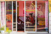 A Chinese prostitute waiting for business, Tsetang, Tibet (Xizang), China.