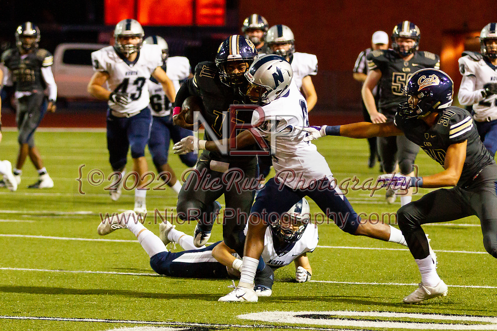 Southmoore's Jaedyn Scott running through the tackle of Edmond North's Ryan Roberts during the game on, Friday, Friday, October 19, 2018, at Moore Stadium.