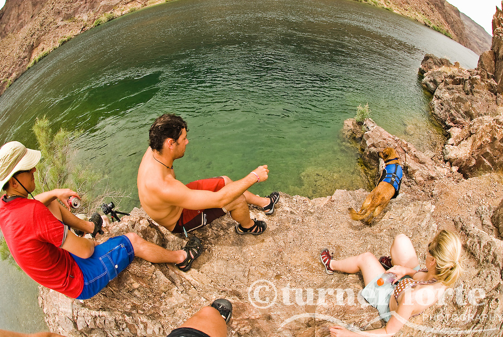 Friends take turns jumping off the cliffs of The Black Canyon, Nevada.