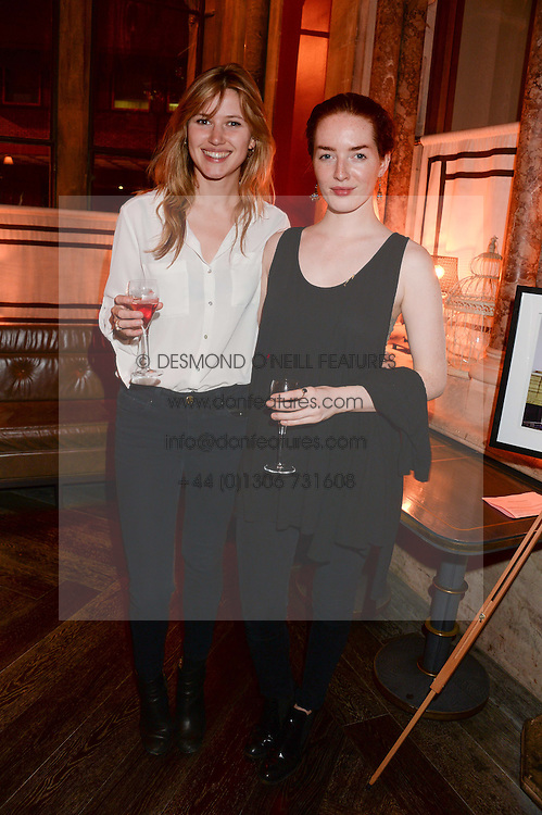 Left to right, EMILY STEER and ASH HALLIBURTON at Models and Mothers Private View, a photographic exhibition in aid of Breakthrough Breast Cancer held at The Gilbert Scott, St Pancras Renaissance Hotel, London, NW1 on 7th October 2013.