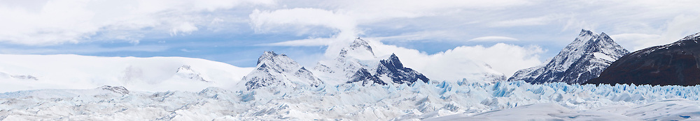 Panoramic view over the Perito Moreno Glacier. The glacier is a popular hiking destination in Los Glaciares National Park, Argentina. The image is stitched from nine individual exposures.