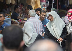 © Licensed to London News Pictures. 17/07/2014. Gaza.   On the tenth day of the war between Hamas and Israel a 5 hour cease fire is agreed.  Residents of Gaza visit the local market in the centre of Gaza.  Photo credit : Alison Baskerville/LNP