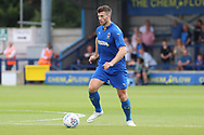 AFC Wimbledon defender Jon Meades (3) dribbling during the Pre-Season Friendly match between AFC Wimbledon and Queens Park Rangers at the Cherry Red Records Stadium, Kingston, England on 14 July 2018. Picture by Matthew Redman.