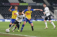 Derby County midfielder Duane Holmes on the ball as the Southampton players challenge during the The FA Cup 3rd round match between Derby County and Southampton at the Pride Park, Derby, England on 5 January 2019.