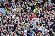 Burnley fans celebrate during the Sky Bet Championship match between Brighton and Hove Albion and Burnley at the American Express Community Stadium, Brighton and Hove, England on 2 April 2016.