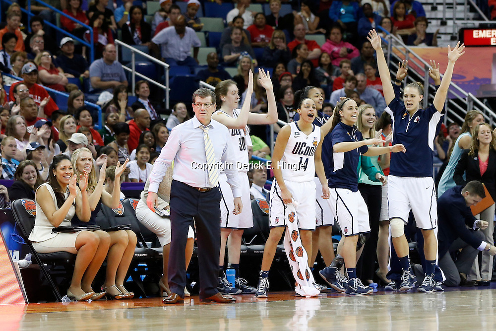 Apr 9, 2013; New Orleans, LA, USA; Connecticut Huskies head coach Geno Auriemma (standing, far left) celebrates with his team against the Louisville Cardinals during the second half of the championship game in the 2013 NCAA womens Final Four at the New Orleans Arena. Mandatory Credit: Derick E. Hingle-USA TODAY Sports