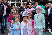 New York, NY, USA-27 March 2016. Five children in colorul Easter outfits pose for photos on Fifth Avenue during the annual Easter Bonnet Parade and Festival.