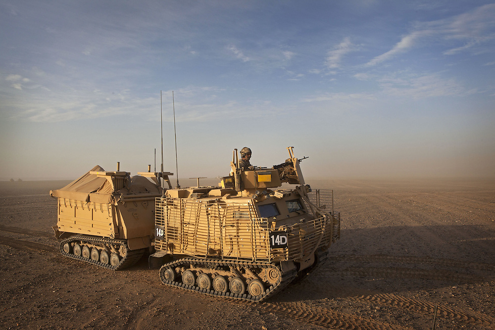 A Warthog armored fighting vehicle is used to transport British soldiers of 16 Air Assault Bde's elite BRF (Brigade Reconnaissance Force) across the desert to an operation in the village of Kakaran in Helmand Province, Southern Afghanistan on the 14th of March 2011.
