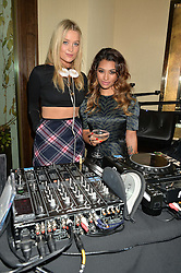 Left to right, LAURA WHITMORE and singer VANESSA WHITE at a party to celebrate the 15th anniversary of Myla held at the House of Myla, 8-9 Stratton Street, London on 21st October 2014.