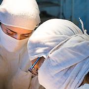CAPTION: Dr Fomenki and Dr Lisina, hard at work operating on Kirill's hard palate. LOCATION: Volgograd City Hospital #1, Volgograd, Russia. INDIVIDUAL(S) PHOTOGRAPHED: Dr Natalia Lisina (left) and Dr Irena Fomenko (right).