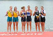 Eton Dorney, Windsor, Great Britain,..2012 London Olympic Regatta, Dorney Lake. Eton Rowing Centre, Berkshire[ Rowing]...Description;   Women's Pair, medals presentation  .Gold Medalist and Centre. GBR W2- Helen GLOVER (b) , Heather STANNING (s).Silver Medalist and Left. AUS.W2- Kate HORNSEY (b) , Sarah TAIT (s).Bronze Medalist and right.  NZL W2- Juliette HAIGH (b) , Rebecca SCOWN (s)  Dorney Lake. 12:29:27  Wednesday  01/08/2012.  [Mandatory Credit: Peter Spurrier/Intersport Images].Dorney Lake, Eton, Great Britain...Venue, Rowing, 2012 London Olympic Regatta...