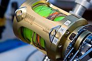 Heavy gold reel with wind on leader and tape marks for various drag settings.