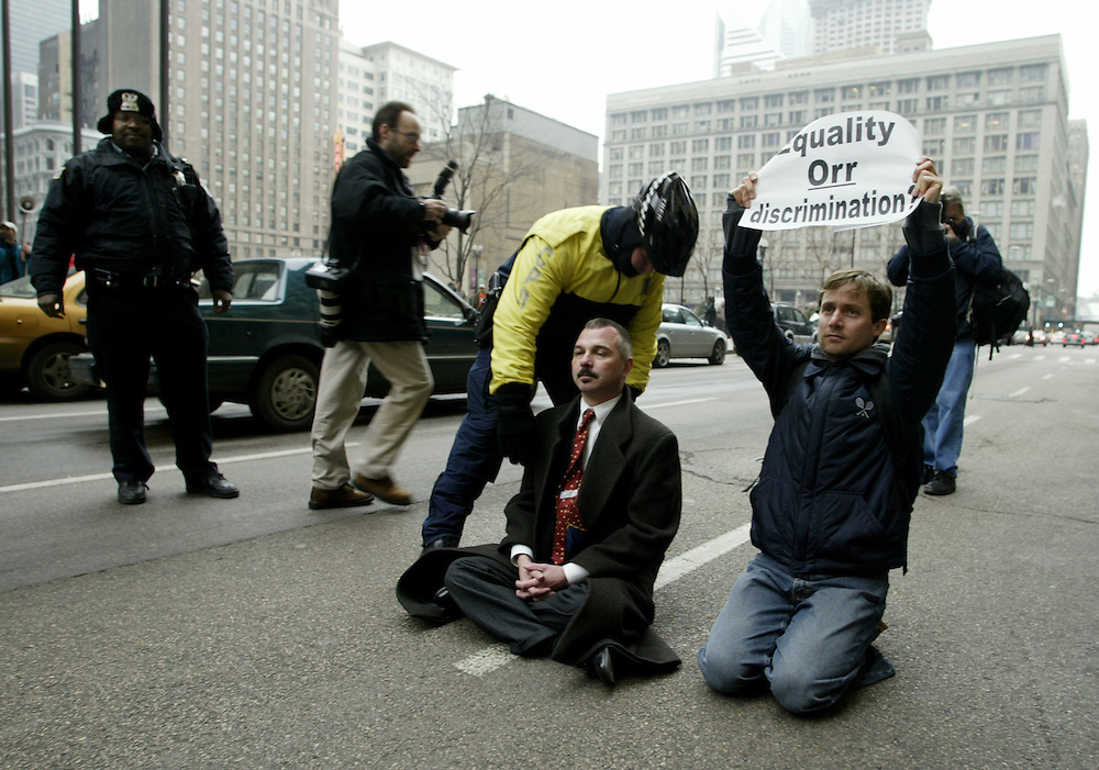 Police remove gay rights protestors sitting in the street in front of the Cook County Administration Building in Chicago.  The protestors were demanding marriage licenses.