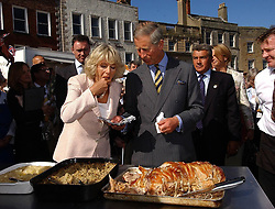 File photo dated 14/09/05 of the Prince of Wales and Duchess of Cornwall visiting a roast pork stall in Richmond Market, North Yorkshire. Charles and Camilla are celebrating their 15th wedding anniversary on Friday, after they were reunited on Monday when the 72-year-old duchess came out of a 14-day self-isolation on the Balmoral estate in Aberdeenshire.