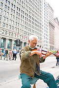 Street musician playing the violin on Michigan Avenue in front of the Art Institute.  Chicago Illinois USA