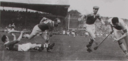 Cork's Paddy Barry on the ground and Christy Ring face Wexford's Bobby Rackard and Nick O'Donnell.