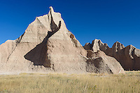 A spire rises above the grassland along the Castle Trail in Badlands National Park.