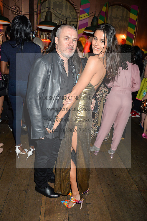 DAMIEN HIRST and KATIE KEIGHT at a party to celebrate the launch of fashion retailer WeKoko.com held at Sketch, 9 Conduit Street, London on 13th April 2016.