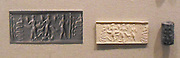 Cylinder seal with impressions, from Mesopotamia. seal made from metadiorite, depicting a snake god and other deities with snake, scorpion and goat features. Akkadian Period, 2350-2150 BC.