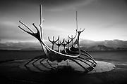 The Sun Voyager (Sólfar) sculpture, by Jón Gunnar Árnason, in Reykjavik, Iceland, just before Sunrise (black & white)