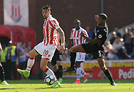 Liverpool's Georgino Wijnaldum challenges Stoke city's Geoff Cameron .Premier league match, Stoke City v Liverpool at the Bet365 Stadium in Stoke on Trent, Staffs on Saturday 8th April 2017.<br /> pic by Bradley Collyer, Andrew Orchard sports photography.