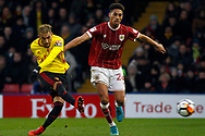 Roberto Pereyra of Watford (L) takes a shot at goal. The Emirates FA Cup, 3rd round match, Watford v Bristol City  at Vicarage Road in Watford, London on Saturday 6th January 2018.<br /> pic by Steffan Bowen, Andrew Orchard sports photography.