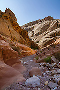 Bell Canyon. Hike a classic loop from Little Wild Horse Canyon to Bell Canyon, in the San Rafael Reef, Utah, USA. This great walk (an 8.6-mile circuit with 900 feet gain) is a short drive on a paved road from Goblin Valley State Park. The hike via fascinating narrow slot canyons and open mesas requires some scrambling over rocks, possibly through shallow water holes (which were dry for us on Sept 20, 2020 but wet in April 2006). Thanks to the greatest legislative victory in the history of SUWA (Southern Utah Wilderness Alliance), in 2019, Congress passed the Emery County Public Land Management Act, which declared 663,000 acres of wilderness, including Little Wild Horse Canyon Wilderness, in San Rafael Swell Recreation Area, Utah, USA. The Navajo and Wingate sandstone of the San Rafael Reef was uplifted fifty million years ago into a striking bluff which now runs from Price to Hanksville, bisected by Interstate 70 at a breach fifteen miles west of the town of Green River.