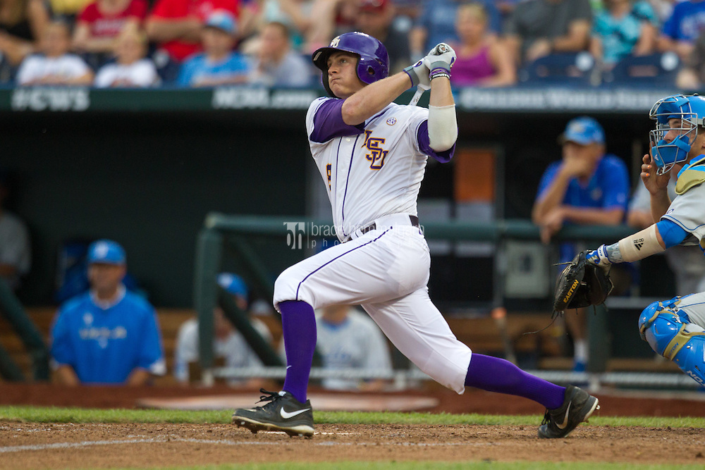 LSU Tigers first baseman Mason Katz #8 hits a home run during Game 4 of the 2013 Men's College World Series between the LSU Tigers and UCLA Bruins at TD Ameritrade Park on June 16, 2013 in Omaha, Nebraska. The Bruins defeated the Tigers 2-1. (Brace Hemmelgarn)