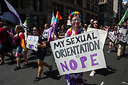 "New York, NY - 30 June 2019. The New York City Heritage of Pride March filled Fifth Avenue for hours with participants from the LGBTQ community and it's supporters. A woman with a group of asexual people carries a sign reading ""My sexual orientation is nope."""