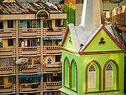 20 OCTOBER 2015 - YANGON, MYANMAR:  The spire for St. John's Catholic Church, a colonial era Catholic church, is nestled in residential community in Yangon. PHOTO BY JACK KURTZ