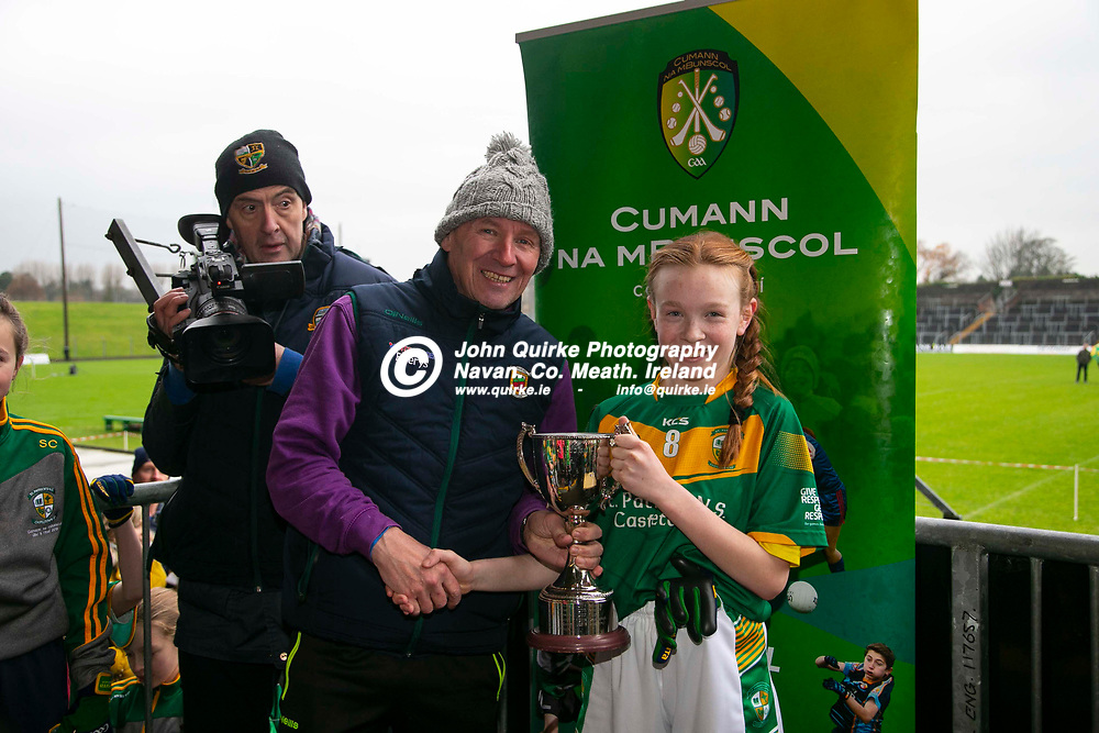 23/11/2019, Cumann na mBunscol Primary School Finals at Pairc Tailteann, Navan<br /> Game 3: Girls Division 5 Football Final<br /> Rathfeigh N.S. vs Castletown N.S.<br /> Gerry Conroy presents the cup to Castletown NS captain, Ciara Sheerin after they defeated Rathfeigh NS in the Girls Division 5 Football Final<br /> Photo: David Mullen / www.quirke.ie ©John Quirke Photography, Unit 17, Blackcastle Shopping Cte. Navan. Co. Meath. 046-9079044 / 087-2579454.<br /> ISO: 800; Shutter: 1/200; Aperture: 4.5; <br /> File Size: 15.1MB