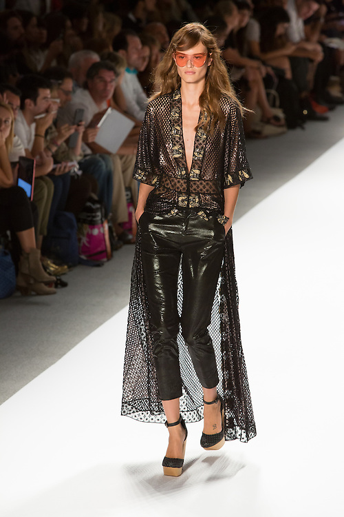 Shiny black pants, lace and perforated top with lace floor-length train. By Custo Barcelona at the Spring 2013 Fashion Week show in New York.