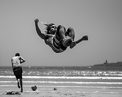 June 22, 2012 - Essaouira, Morocco - The wide sandy beaches of Essauira offer space for sports like football and capoeira. In this case the two disciplines are fused together.  (Credit Image: RealTime Images)