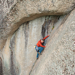 Bryan Gilmore leading Book of Solemnity, 5.10a on Cathedral Ledge in North Conway, New Hampshire