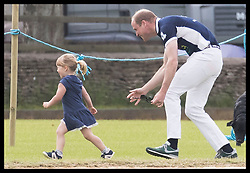 June 11, 2017 - Westonbirt, United Kingdom - Image licensed to i-Images Picture Agency. 11/06/2017. Westonbirt, United Kingdom. The Duke of Cambridge chases Mia Tindall, the daughter of  Zara Philips at the  Maserati Royal Charity Polo Trophy at Beaufort Polo Club in Westonbirt, Gloucestershire, United Kingdom. Picture by Stephen Lock / i-Images (Credit Image: © Stephen Lock/i-Images via ZUMA Press)