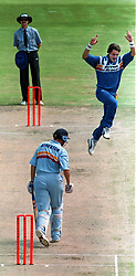 Western Province bowler Meyrick Pringle celebrates the wicket of England captain Michael Atherton who was dismissed for 2 runs, during the one-day match at the Newlands, Cape Town.
