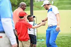 May 5, 2018 - Charlotte, NC, U.S. - CHARLOTTE, NC - MAY 05: Peter Ulhein slaps hands with some young fans during the 3rd round of the Wells Fargo Championship on May 05, 2018 at Quail Hollow Club in Charlotte, NC. (Photo by William Howard/Icon Sportswire) (Credit Image: © William Howard/Icon SMI via ZUMA Press)