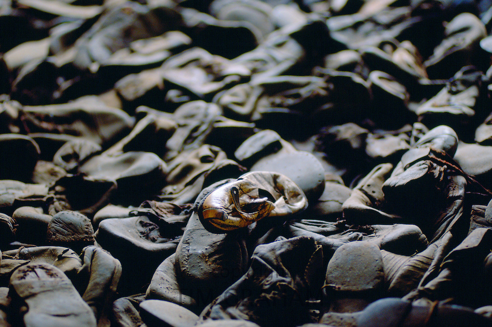 Majdanek Concentration Camp - a child's shoe lies among shoes discarded from Jewish victims of the Holocaust, Poland.