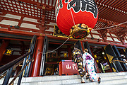 A Japanese couple dressed in kimono enter the main hall of the Sensoji Buddhist temple in Asakusa, Tokyo, Japan. The temple was built during the Kamakura period in 645 CE and is the oldest and most important temple in Tokyo.