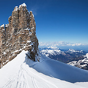A view of ski tracks and a rock formation on Mount Titlis near Engelberg, Switzerland, in the Ulmer Alps.<br /> <br /> + ART PRINTS +<br /> To order prints or cards of this image, visit:<br /> http://greg-stechishin.artistwebsites.com/featured/mount-titlus-1-greg-stechishin.html
