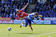 Reading's Chris Gunter collides with Southampton's Jay Rodriguez. Barclays Premier league, Reading v Southampton at the Madejski stadium in Reading on Saturday 6th April 2013. pic by Andrew Orchard, Andrew Orchard sports photography,