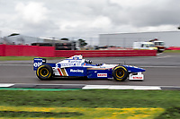 Damon Hill at the The Classic Silverstone  , looking pleased to be reunited with his 1996 Championship winning Williams FW18 Chris Wynne