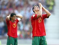 Fotball<br /> EURO 2004<br /> Portugal<br /> 12.06.2004<br /> NORWAY ONLY<br /> <br /> Hellas v Portugal<br /> <br /> Foto: Scott Heavey/Digitalsport<br /> <br /> Christiano Ronaldo looks for help as his side go 2-1 down