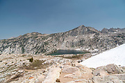 The view along the John Muir Trail overlooking Warrior Lake, John Muir Wilderness, Sierra National Forest, Sierra Nevada Mountains, California, USA.