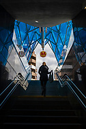 Warsaw, Poland - September 10, 2015: A woman exits a station on the Warsaw metro, which began operation in 1995.