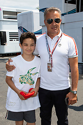 Jean Alesi and his son Giuliano pose along the pit lane during the Grand Prix de France 2018, Le Castellet on June 23rd, 2018. Photo by Marco Piovanotto/ABACAPRESS.COM