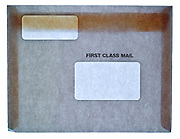 front view of a large first class mail business envelope with two address windows