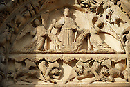 West Facade, Left Portal - General View of Tympanum c. 1145. Cathedral of Chartres, France . The tympanum of the left door shows the Ascension or the Second Coming. Christ (crossed halo) stands on a cloud, supported by two angels. Below are four angels (descending from the clouds?) Some of them have their mouths open (singing?). On the lintel below are ten seated men holding books or scrolls and looking upward (apostles?). On the archivolts are the Signs of the Zodiac and the Labors of the Months.. A UNESCO World Heritage Site. .<br /> <br /> Visit our MEDIEVAL ART PHOTO COLLECTIONS for more   photos  to download or buy as prints https://funkystock.photoshelter.com/gallery-collection/Medieval-Middle-Ages-Art-Artefacts-Antiquities-Pictures-Images-of/C0000YpKXiAHnG2k